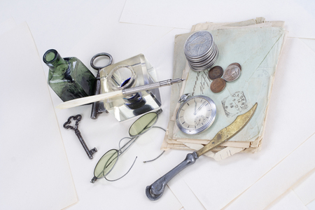 ink pot: Vintage background with old pocket watch, old ink pen, handwritten letters and old ink pot Stock Photo