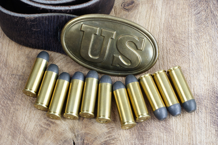 buckle: US Belt Buckle Civil War period with revolver cartridges on wooden background