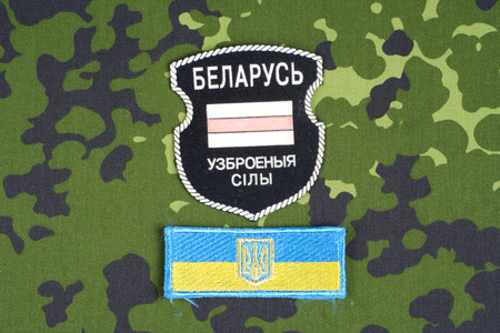 illustrative material: KIEV, UKRAINE - August, 06, 2015. Belarusian volunteers in Ukraine  Army. Russian-Ukraine war 2014 - 2015. Unofficial uniform badge with identification dog-tags Editorial
