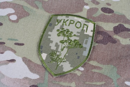 illustrative material: KIEV, UKRAINE - Apr. 26, 2015. Ukraine Army unofficial uniform badge UKROP