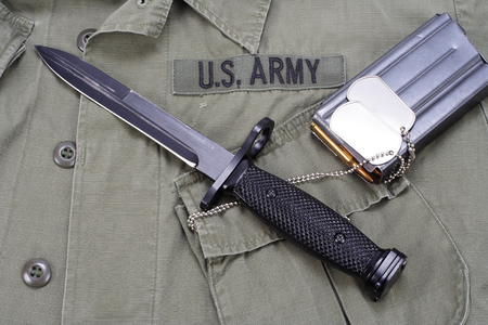 m16 ammo: M16 rifle bayonet on uniform bacground