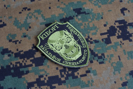 illustrative material: KIEV, UKRAINE - July, 08, 2015. Ukraine Army unofficial uniform badge CYBORG
