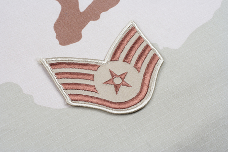 us air force: KIEV, UKRAINE - May 18, 2015. US AIR FORCE Staff Sergeant rank patch on desert uniform