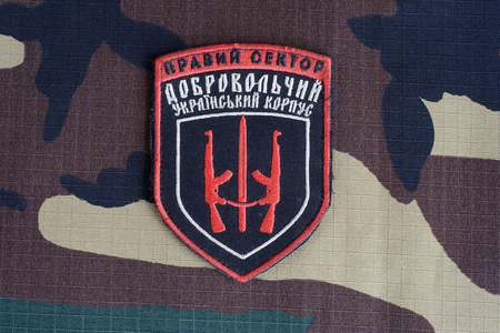 illustrative material: KIEV, UKRAINE - July, 08, 2015. Chevron of Ukrainian volunteers corps with the words Ukrainian Volunteer Corps Right Sector