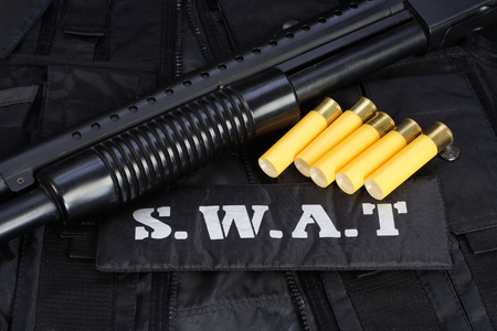 swat teams: Special weapons and tactics team equipment on black background Stock Photo