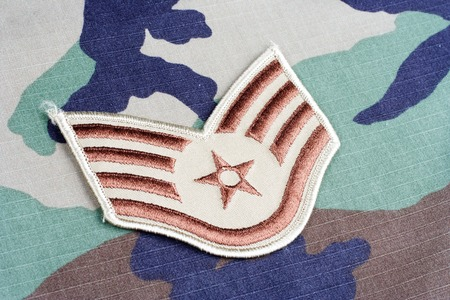 us air force: KIEV, UKRAINE - June 6, 2015. US AIR FORCE Staff Sergeant rank patch on woodland camouflage uniform Editorial