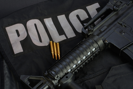 emergency vest: Special weapons and tactics team equipment on black background Stock Photo