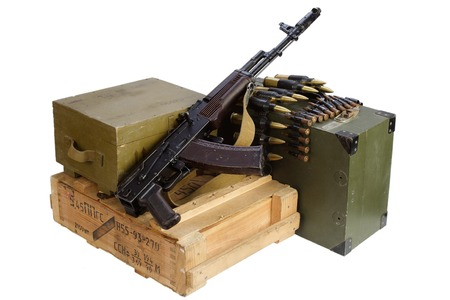 vintage military rifle: army box of ammunition with AK rifle and ammunition isolated Editorial