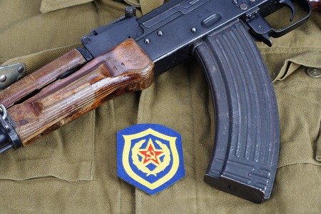 infantry: AK47 with Soviet Army Mechanized infantry shoulder patch on  khaki uniform background