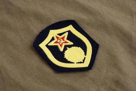 Soviet Army chemical troops shoulder patch on khaki uniform background Stock Photo