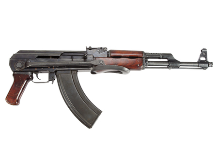communism: Rare first model AK - 47 assault rifle isolated on white