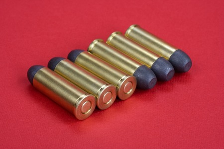 The .45 Revolver cartridges Wild West period on  red background