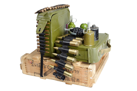 army box of ammunition with ammo belt and hand grenades isolated Editorial