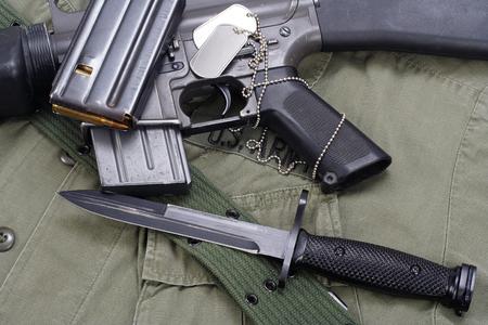 bayonet: M16 rifle bayonet on uniform bacground