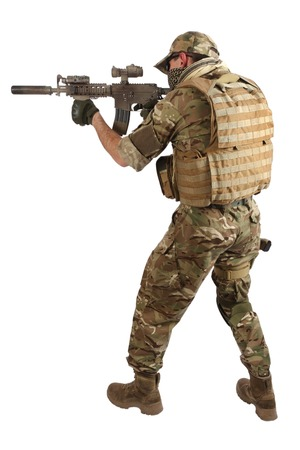 gi: special forces operator with assault rifle on white background