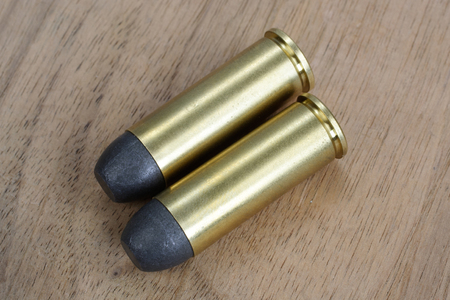 45 ammo: The .45 Revolver cartridges dating to 1872 on wooden background