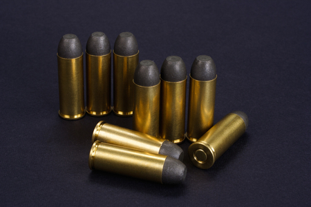 The .45 Revolver cartridges Wild West period on black background