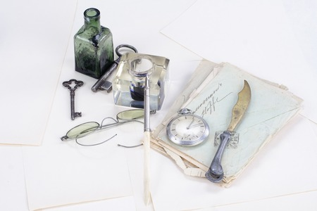 ink pot: Vintage background with old pocket watch, old ink pen, handwritten letters and old ink pot Editorial