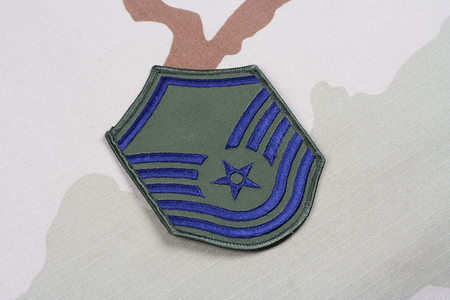 us air force: KIEV, UKRAINE - May 18, 2015. US AIR FORCE Master Sergeant rank patch on desert uniform