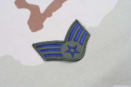 us air force: KIEV, UKRAINE - May 18, 2015. US AIR FORCE Senior Airman rank patch on desert uniform