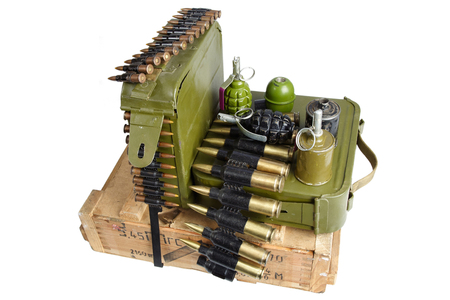 army box of ammunition with ammo belt and hand grenades isolated Stock Photo