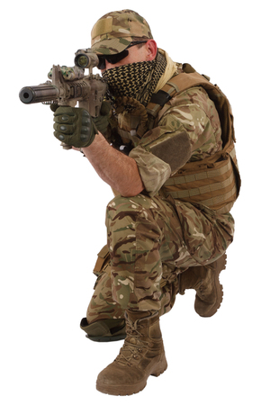 infantryman: special forces operator with assault rifle on white background