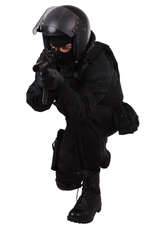 police special forces officer with submachine gun in black uniform isolated on white