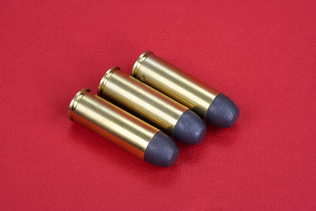 45 ammo: The .45 Revolver cartridges dating to 1872 on red background Stock Photo