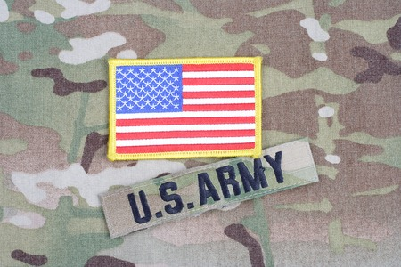 us army: KIEV, UKRAINE - September 5, 2015. US ARMY branch tape with flag patch on camouflage uniform