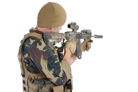 iraq: Private Military Company operator with assault rifle on white background