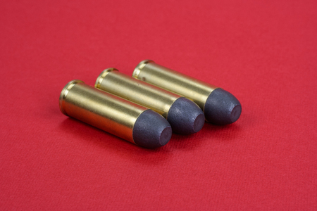 45 ammo: The .45 Revolver cartridges Wild West period on  red background