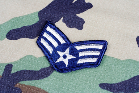 us air force: KIEV, UKRAINE - June 6, 2015. US AIR FORCE Senior Airman rank patch on woodland camouflage uniform