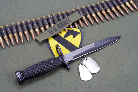 m16 ammo: KIEV, UKRAINE - May 18, 2015. US ARMY 1st Cavalry Division patch and M16 rifle bayonet on uniform background