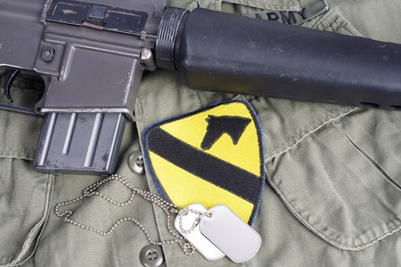 m16 ammo: KIEV, UKRAINE - May 18, 2015. US ARMY 1st Cavalry Division patch with M16 rifle on uniform background