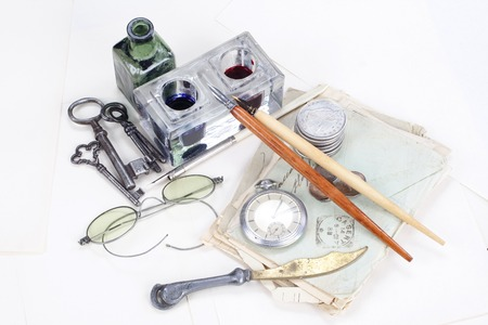 Vintage background with old pocket watch, old ink pen, handwritten letters and old ink pot Stock Photo