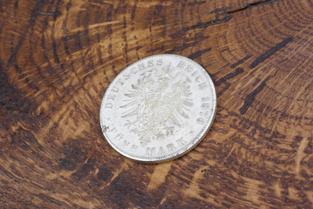 old vintage silver dollar on wooden background Stock Photo