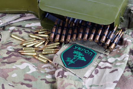 KIEV, UKRAINE - July, 08, 2015. Ukraine Army unofficial uniform badge UKROP with military ammunition