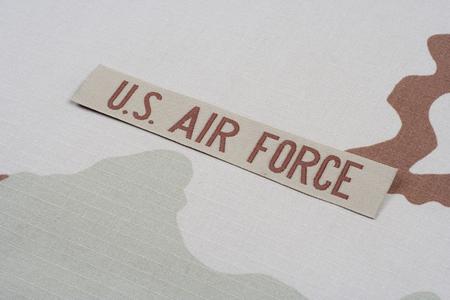 KIEV, UKRAINE - May 9, 2015. US AIR FORCE branch tape on desert camouflage uniform background