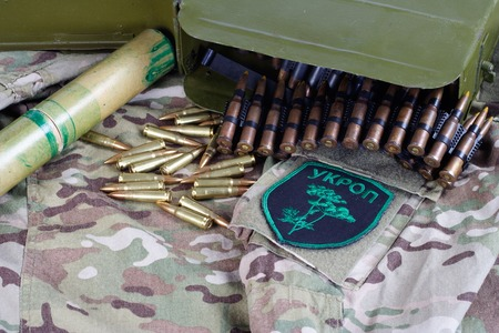 KIEV, UKRAINE - July, 08, 2015. Ukraine Army unofficial uniform badge UKROP with military ammunition