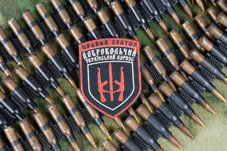 KIEV, UKRAINE - July, 08, 2015. Chevron of Ukrainian volunteers corps with the words Ukrainian Volunteer Corps Right Sector with military ammunition Editorial