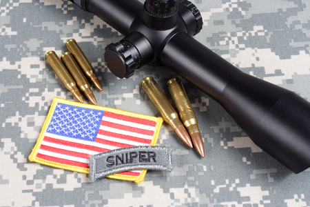 KIEV, UKRAINE - September 5, 2015. US ARMY background concept - sniper with scope and insignia