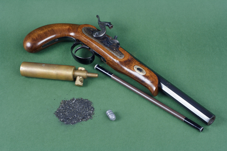 Adventurer set - pistol with an accessory on green background 版權商用圖片 - 97867056