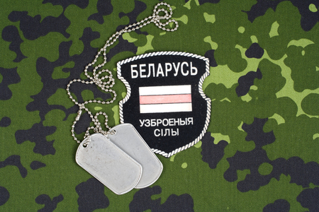 KIEV, UKRAINE - August, 06, 2015. Belarusian volunteers in Ukraine  Army. Russian-Ukraine war 2014 - 2015. Unofficial uniform badge with identification dog-tags 에디토리얼