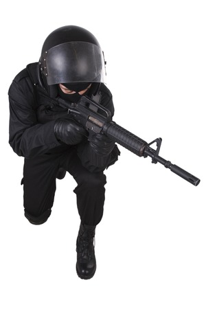 SWAT officer with assault rifle in black uniform isolated on white