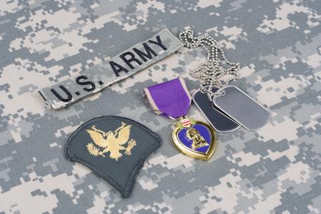 KIEV, UKRAINE - March 6, 2016. Purple Heart award with dog tags on US ARMY camouflage uniform