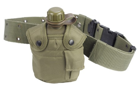Army water canteen with pistol belt isolated Stock Photo