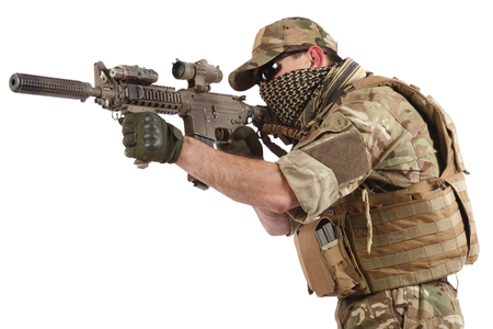 Private Military Company operator with assault rifle on white background