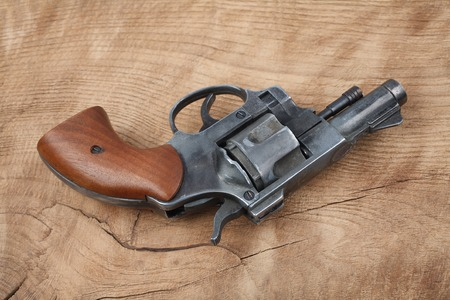 Revolver on the wooden table Stock Photo