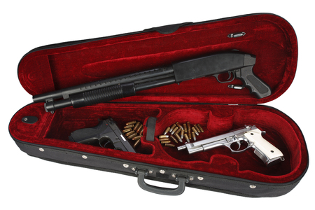 Sawn-off shotgun and handguns with cartridges in violin case Stock Photo