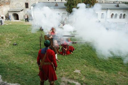 KAMYANETS-PODILSKY, UKRAINE - SEPTEMBER 26, 2010: Members of history club wear historical uniform 17 century during historical reenactment